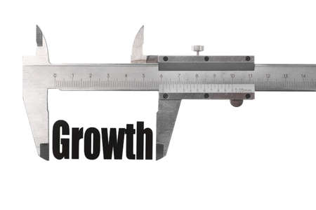 Detail of a caliper measuring the word Growth. 版權商用圖片