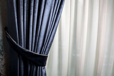 window curtains: Color shot of a luxury curtain in a home