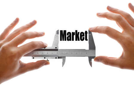 caliper: Close up shot of a caliper measuring the word Market