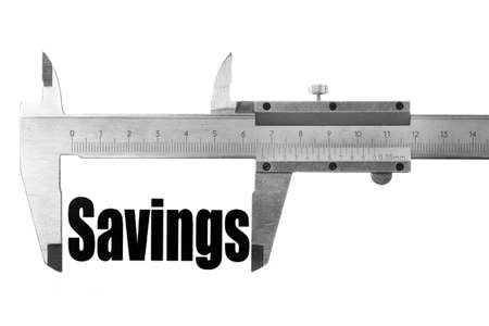 Two hands holding a caliper, measuring the word Savings. photo