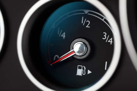 Close-up shot of a fuel gauge in a car photo