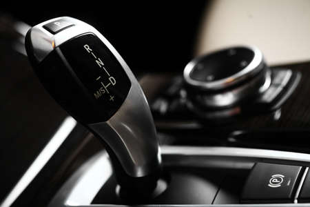 Detail on a automatic gear shifter in a new car Imagens