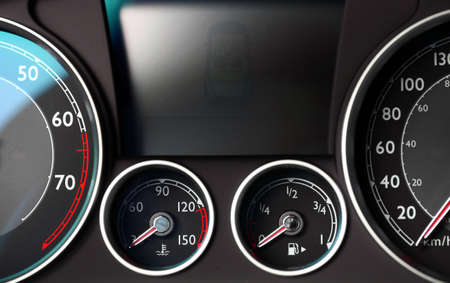 rev counter: Color detail with the gauges on the dashboard of a car Stock Photo