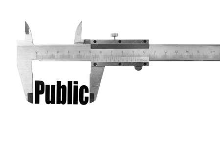 caliper: Close up shot of a caliper measuring the word Public Stock Photo