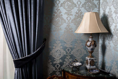 baroque room: Color picture of an old table lamp