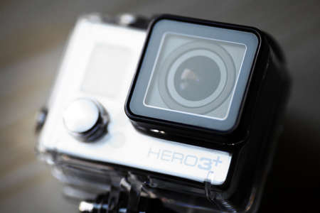 Bucharest, Romania - November 5, 2013: Close up color shot of a GoPro Hero 3+ action camera. GoPro is a brand of high-definition cameras used in extreme action video photography produced by a company that is privately owned Woodman Labs of San Mateo, Cali