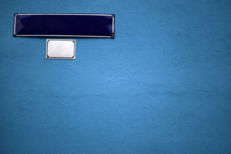 Color shot of an empty blue street sign on a blue wall photo