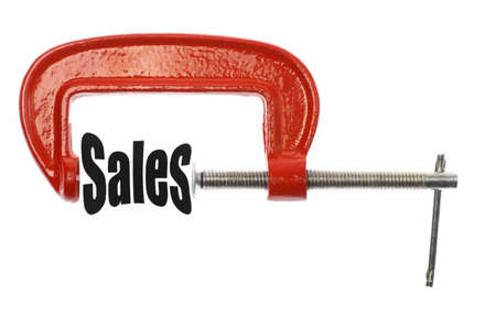 compressed: The word Sales is compressed with a vice. Business metaphor. Stock Photo