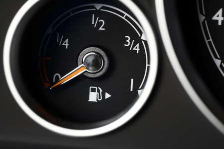 Close-up shot of a fuel gauge in a car