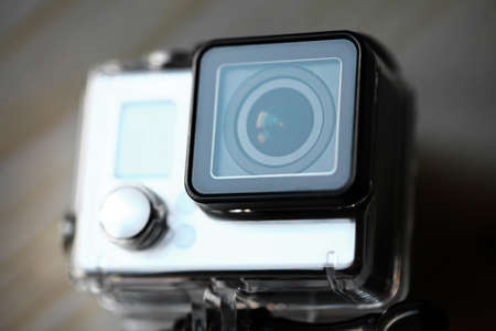 Close up color shot of a small action camera photo