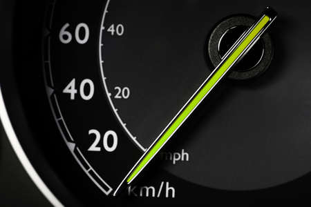 Close up shot of a speedometer in a car photo