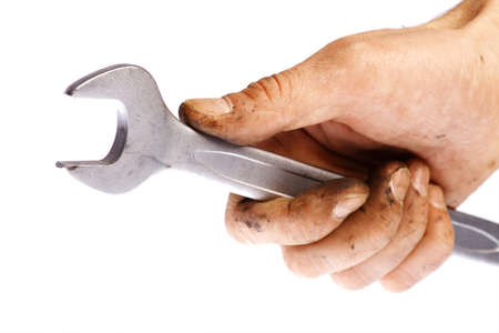 Close-up shot of a hand holding a wrench, isolated on white  photo