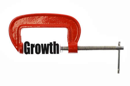 compressed: The word Growth is compressed with a vice. Business metaphor.