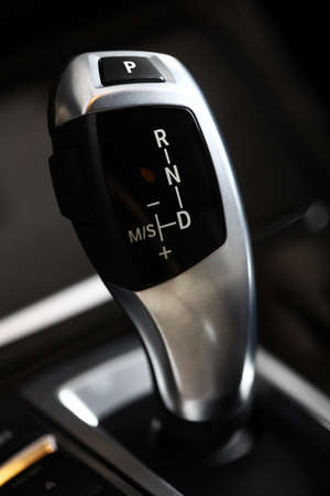 shifter: Detail on a automatic gear shifter in a new car Stock Photo
