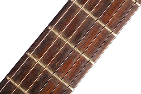 fret: Close-up shot of the fret board of a classical guitar