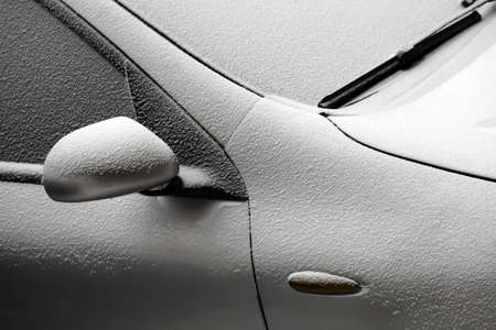 Close-up shot of a car covered in snow photo