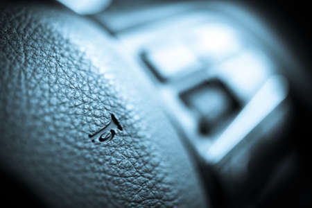 Close up shot of the horn button on a car's steering wheel photo