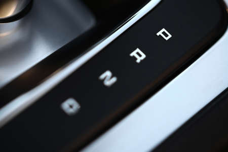shifter: Close-up shot of the positions of an automatic gear shifter in a car.