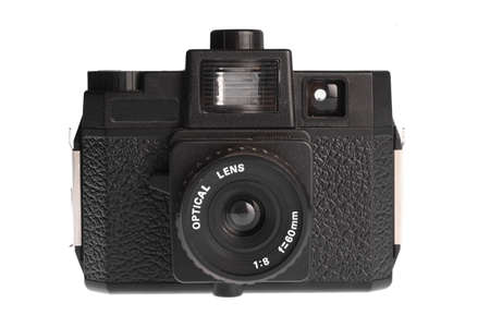 An old film plastic camera isolated on white. photo