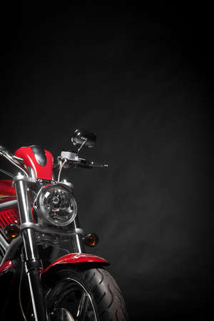 Color shot of a red motorcycle on a black background. Banque d'images