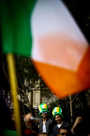 Bucharest, Romania - March 16, 2014: Two men take part in a parade celebrating Saint Patricks day in Bucharest, Romania.  Saint Patrick is the patron saint of Ireland and credited with bringing Christianity to Ireland.