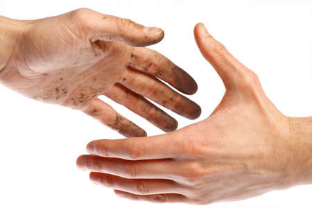 Handshake with a dirty hand and a clean one. photo