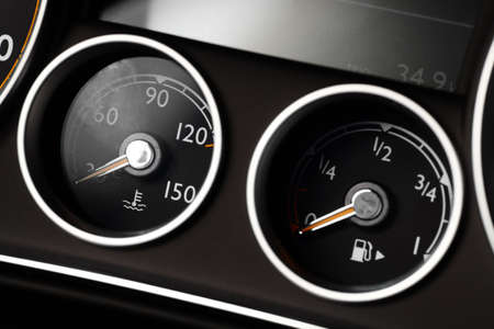 coolant: Coolant temperature and fuel level gauges on a cars dashboard