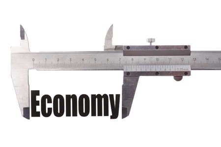 caliper: Close up shot of a caliper measuring the word Economy