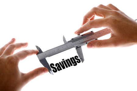Two hands holding a caliper, measuring the word Savings.