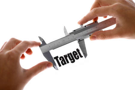 financial target: Close up shot of a caliper measuring the word Target.