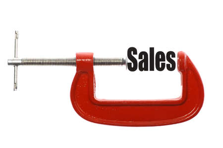 exact: The word Sales is compressed with a vice. Business metaphor. Stock Photo