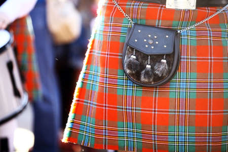 Color detail of a traditional Scottish kilt, with a bag.