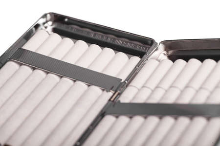 cigarette case: Color detail of a cigarette case with white cigarettes. Stock Photo