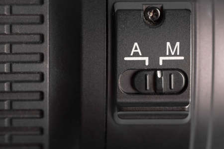 auto focus: Detail of the auto focus switch on a photo lenses