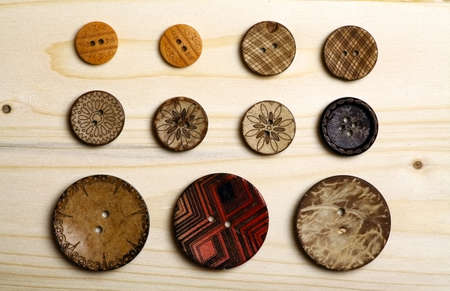 Close up color shot of some wooden buttons. photo