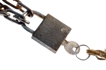 A padlock and a key, isolated on white. photo