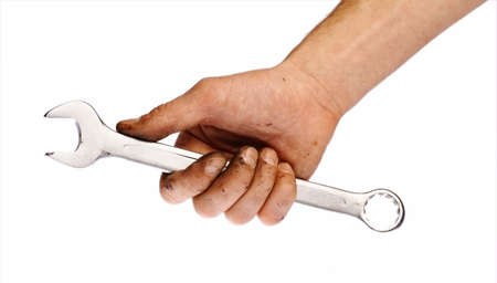 Close-up shot of a hand holding a wrench, isolated on white. photo