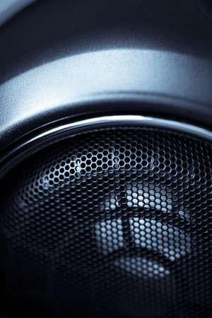 Close up shot of a round speaker in a car. photo