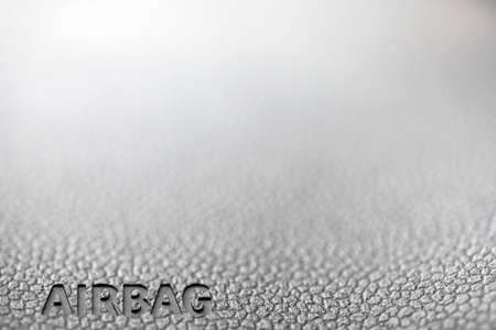 The word Airbag is written on a cars dashboard. photo