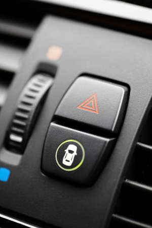 flashers: Detail of a warning button in a car. Stock Photo