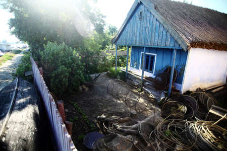 Color picture of a fishermans house in Romanias Danube delta.