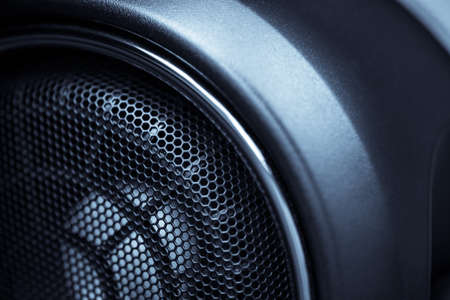 audio speaker: Close up shot of a round speaker in a car. Stock Photo