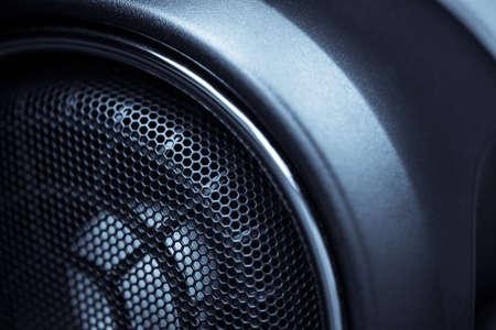 speaker: Close up shot of a round speaker in a car. Stock Photo