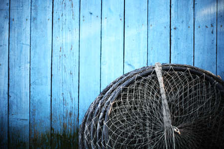 fishing industry: Color detail of a fishing net left to dry.