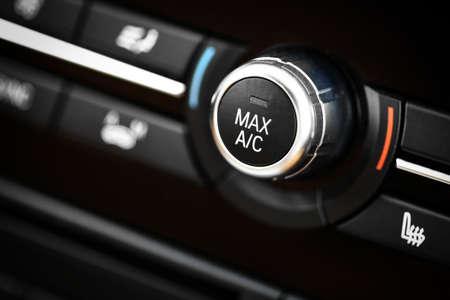 Color detail with the air conditioning button inside a car. Reklamní fotografie - 32144114