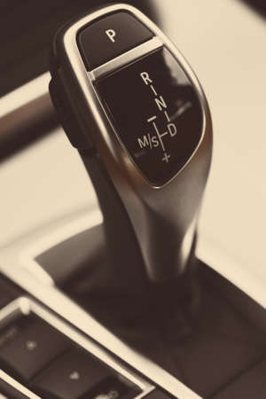 Detail on a automatic gear shifter in a new car. photo