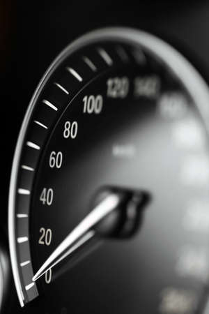 Close up shot of a speedometer in a car. photo