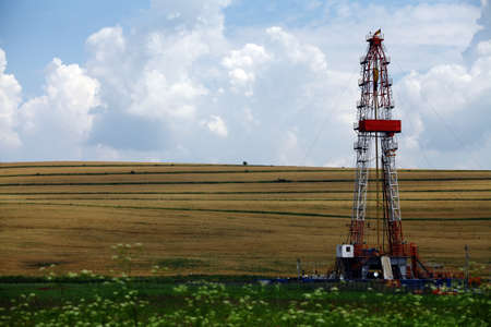 drilling: Color shot of a shale gas drilling rig on a field. Stock Photo