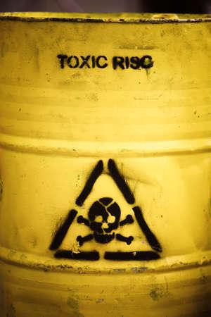 Toxic waste symbol on a yellow barrel. Foto de archivo