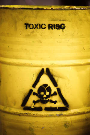 Toxic waste symbol on a yellow barrel. Stock Photo